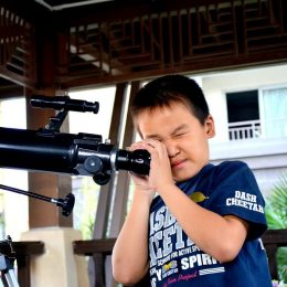 telescope and young kid